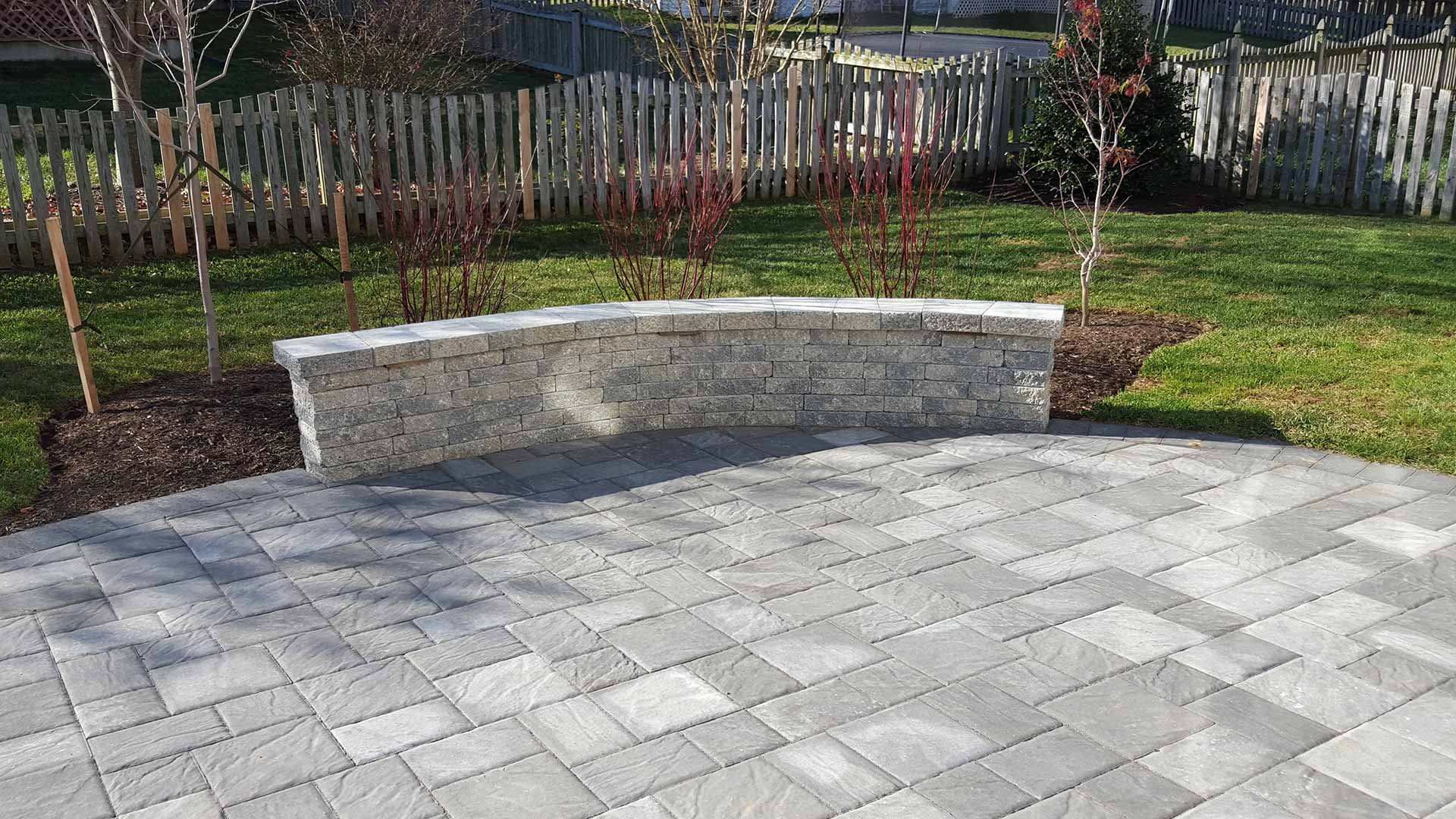 Custom patio with seating wall in Bristow, %%state.