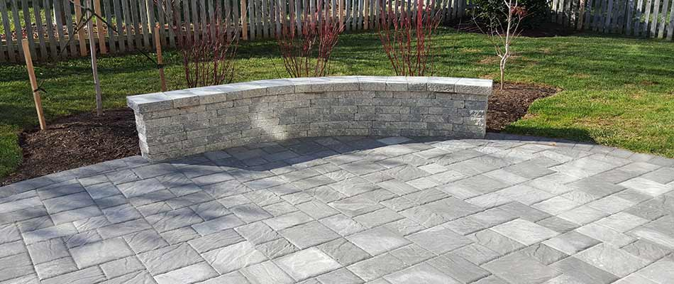 Concrete paver patio design with seating wall near Haymarket, VA.