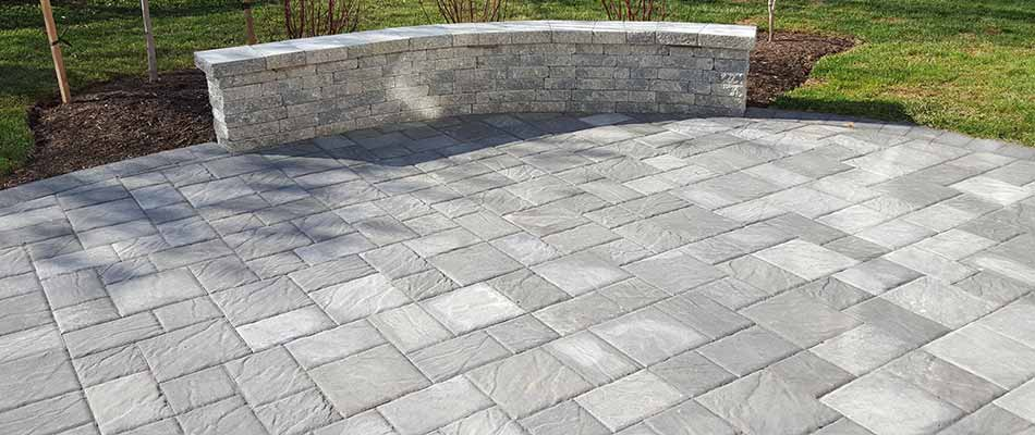 Custom paver patio and seating wall built at a Haymarket, VA home.
